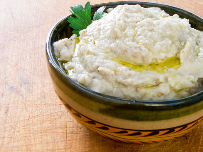 Roasted garlic baba ganoush is another dip recipe that is gluten-free and paleo-friendly. The traditional ingredients are eggplant, tahini, garlic and lemon. | cookeatpaleo.com