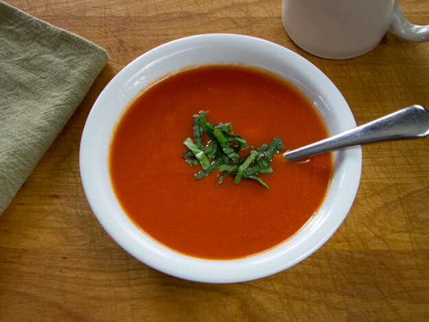 10-Minute Paleo Tomato Soup is a quick and easy dairy-free, paleo tomato soup with intense tomato flavor and a hint of heat and garlic. | cook Eat Paleo