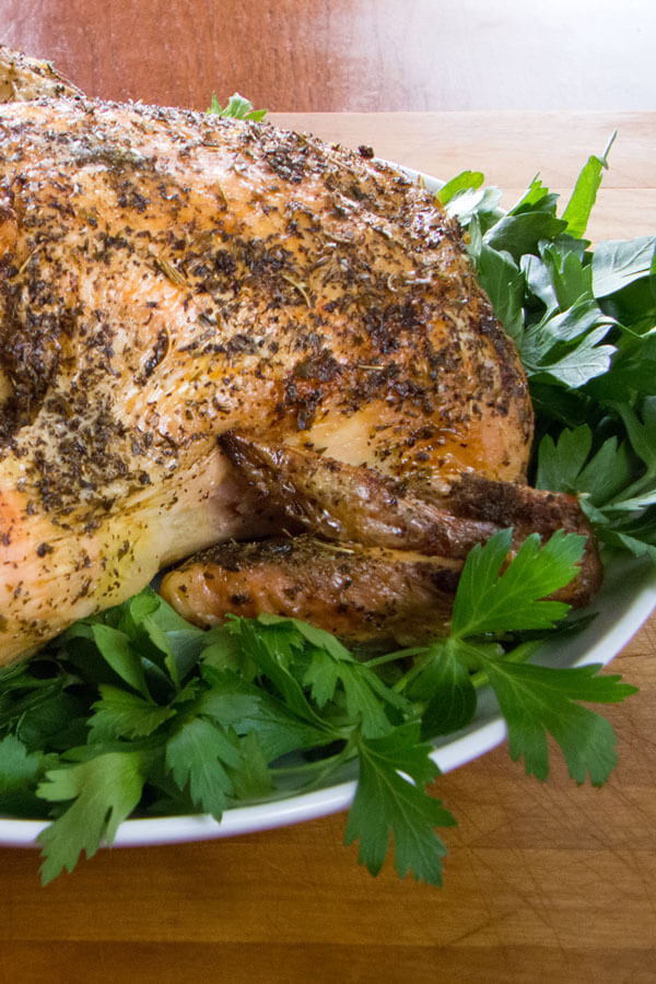 How to roast a chicken - this simple herb lemon garlic roast chicken recipe is deceptively easy and pretty much foolproof. {gluten-free, dairy-free, paleo} | Cook Eat Paleo