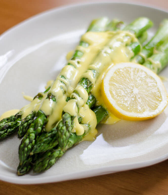 Roasted asparagus with easy Hollandaise sauce is a quick and easy paleo side dish perfect for entertaining.