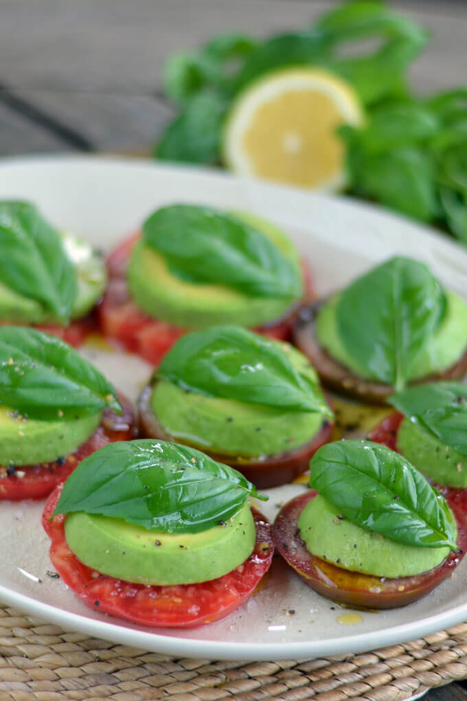 Avocado Caprese Salad - a paleo take on a Caprese salad with tomatoes and basil fresh from the garden. Heirloom tomato avocado salad is the perfect summer salad. | cookeatpaleo.com