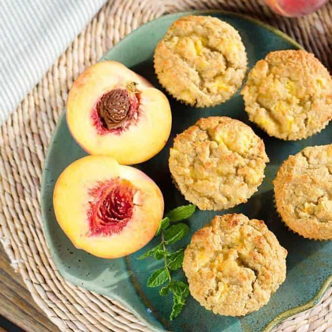 I love the chunks of peaches baked into this fresh peach paleo muffins recipe. The flavor of the peaches is wonderful with the almond, honey and lemon. {gluten-free, grain-free} | cookeatpaleo.com