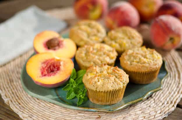 Fresh Peach Paleo Muffins with chunks of peaches baked in. The flavor of the peaches is wonderful with the almond, honey and lemon. {gluten-free, grain-free} | cookeatpaleo.com