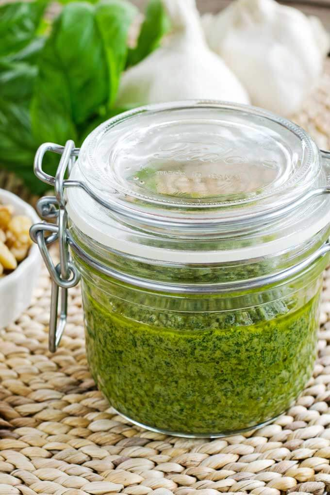 This roasted garlic walnut pesto recipe is so easy and it's my favorite sauce for spiralizer zucchini noodles. It's dairy-free and gluten-free. | Cook Eat Paleo