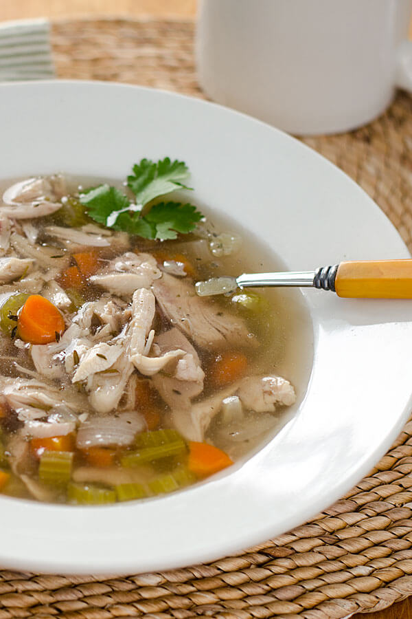 This paleo crock pot chicken soup is comfort food pure and simple. With just a few ingredients, this recipe is gluten-free, grain-free and dairy-free.