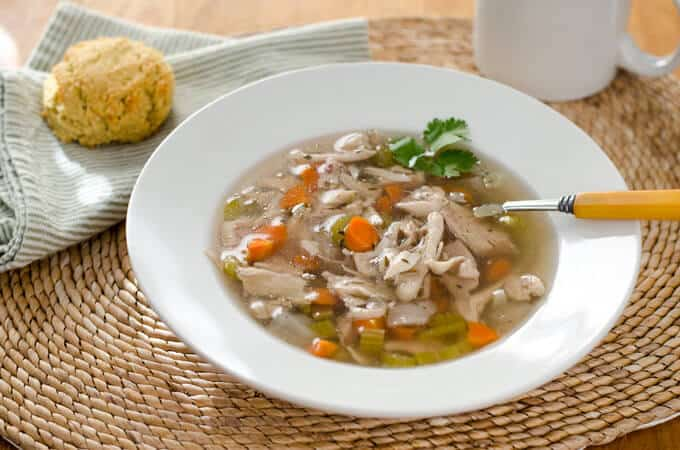 Paleo crock pot chicken soup is comfort food pure and simple. With just a few ingredients, this recipe is gluten-free, grain-free and dairy-free.