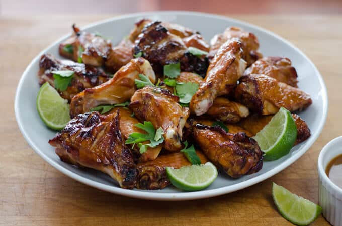 Crispy smoked chicken wings on white plate