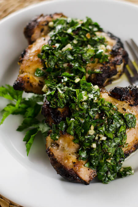 Grilled Chicken with Chimichurri Sauce - the chimichurri doubles as the marinade and sauce. It's a quick and easy, paleo, gluten-free, weeknight meal. | cookeatpaleo.com/grilled-chicken-with-chimichurri-sauce