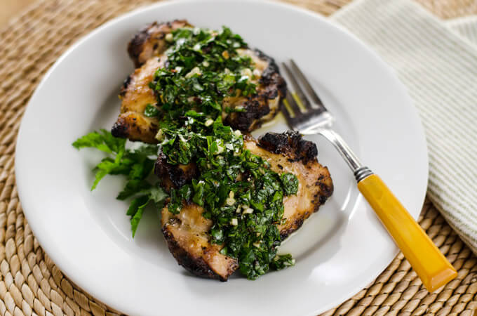 Grilled Chicken with Chimichurri Sauce - the chimichurri doubles as the marinade and sauce. It's a quick and easy, paleo, gluten-free, weeknight meal. | cookeatpaleo.com
