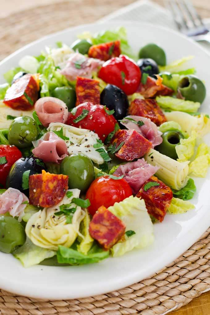 Antipasto salad with prosciutto, salami, olives, peppers, artichokes, lettuce