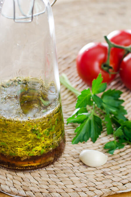 The best Italian dressing recipe - so easy to make. Just throw a few fresh ingredients in a bottle and shake. It's paleo, gluten-free, and dairy-free. | cookeatpaleo.com