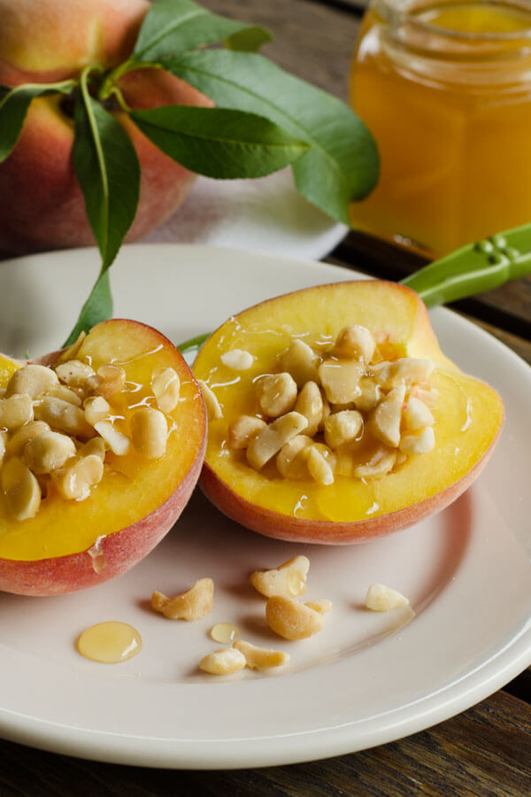 This is my new favorite easy summer dessert — peaches with macadamias and honey. It's quick and easy gluten-free treat. | cookeatpaleo.com