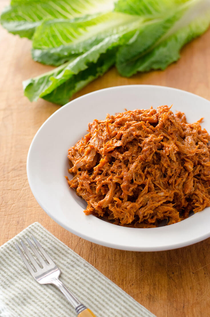 This easy crock pot pulled pork recipe takes just 5 minutes to prep. You can use the pulled pork for make-ahead paleo meals during the week.
