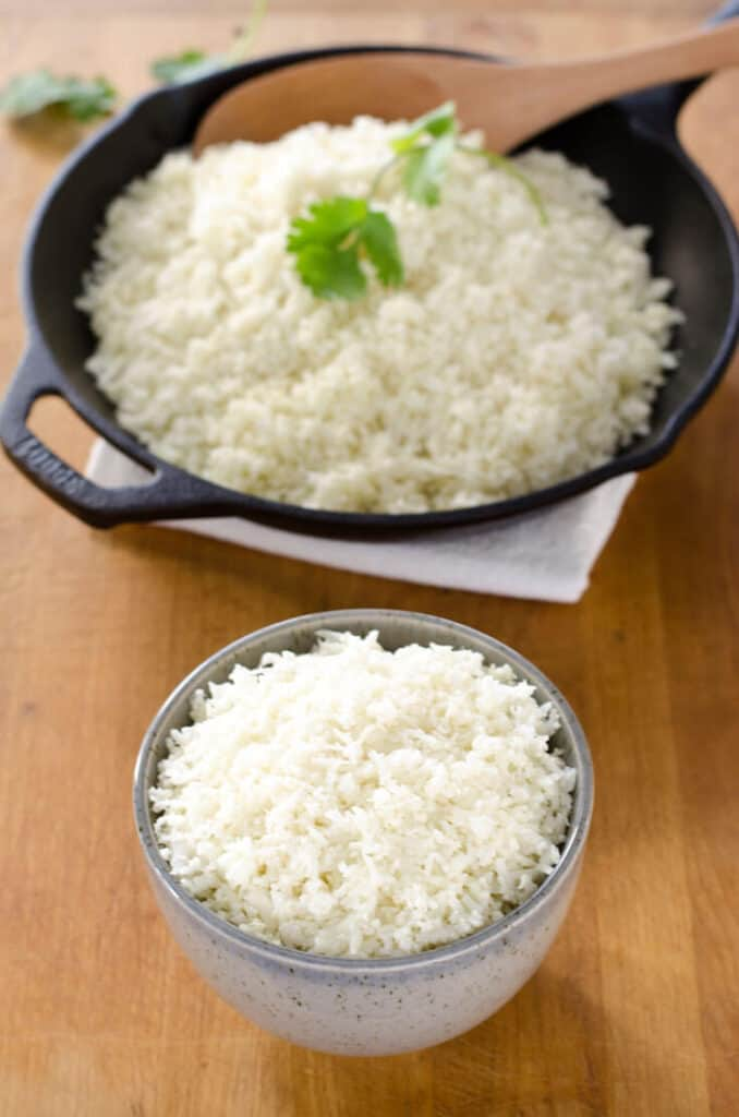 How to make cauliflower rice and stock your refrigerator or freezer with a 5-minute paleo side dish that will go with just about anything. {gluten-free, grain-free, paleo} | cookeatpaleo.com
