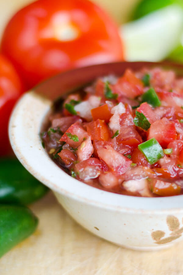 Fresh tomato salsa is wonderful with homegrown summer tomatoes. The recipe is simplicity itself — fresh tomatoes, onion, jalapeno and cilantro.  | cookeatpaleo.com