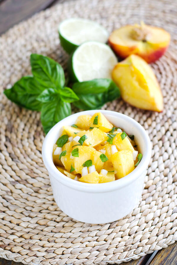 The flavors of summer come together in this fresh peach basil salsa. It's paleo, gluten free, grain free, and perfect with grilled seafood, chicken or pork. |cookeatpaleo.com