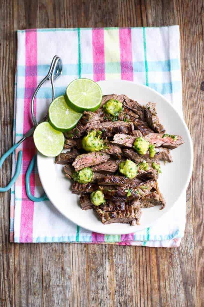 Marinated skirt steak with cilantro lime ghee recipe from the Paleo Plant cookbook.