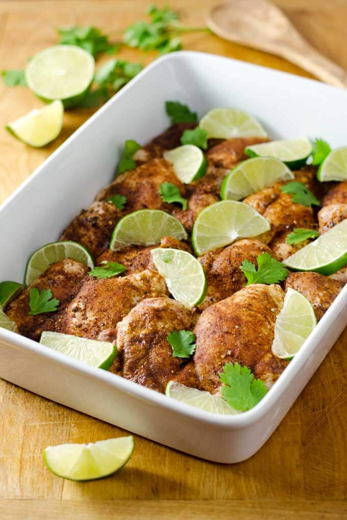 Roasted chicken thighs with lime and cilantro in baking dish
