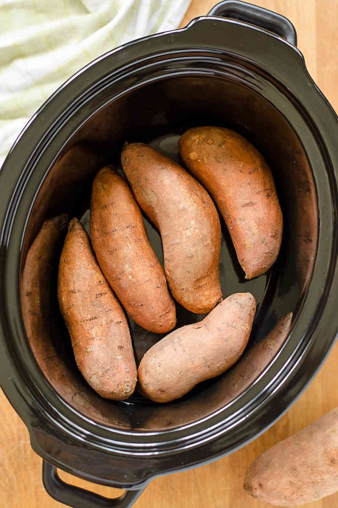 Slow cooker sweet potatoes---the easy way to cook sweet potatoes when you don't want to turn on the oven. Quick, easy, gluten-free, paleo, vegan - perfect for busy days and make ahead meals!