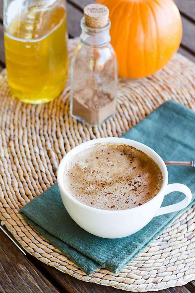 Pumpkin Spice Coconut Latte recipe includes all the flavors of fall — pumpkin, honey, and spice. Coconut milk makes it rich, creamy and dairy-free. | Cook Eat Paleo