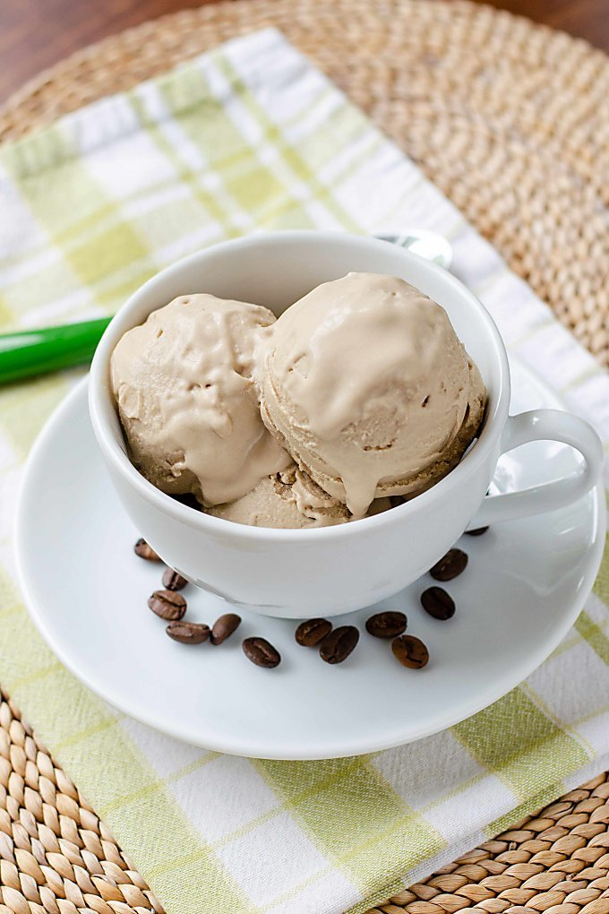 Dairy free coffee ice cream in coffe cup with coffee beans