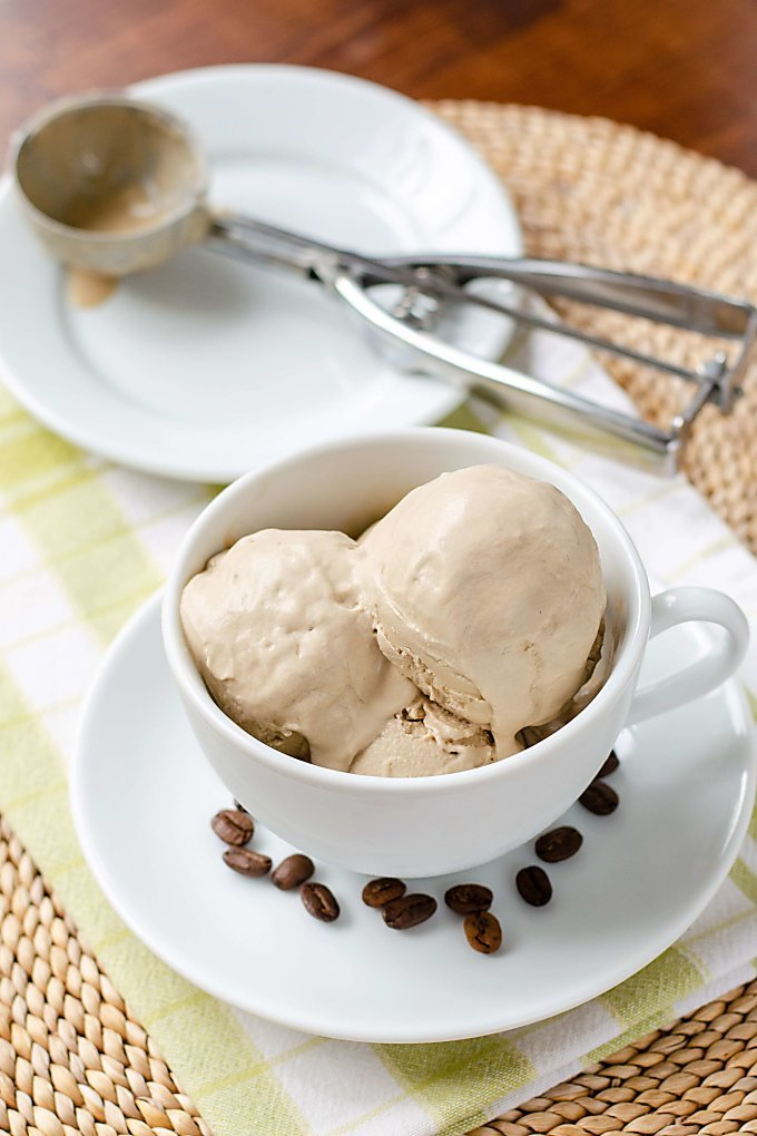 Dairy free ice cream in coffee cup, ice cream scoop