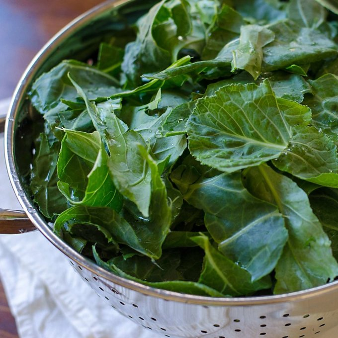 Fresh collard greens in colander