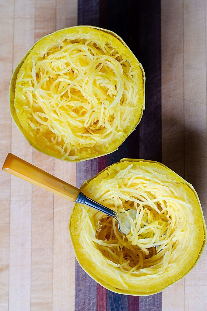 Pressure cooked spaghetti squash halves on cutting board