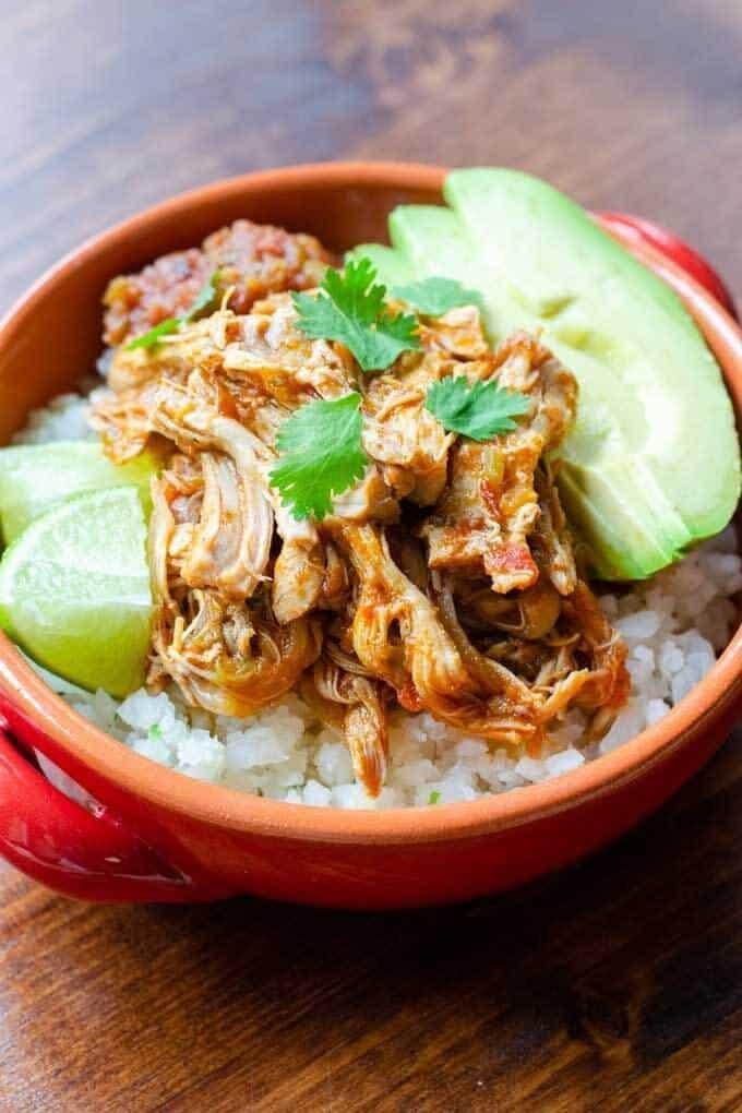 Salsa chicken burrito bowl with cauliflower rice, avocado and lime