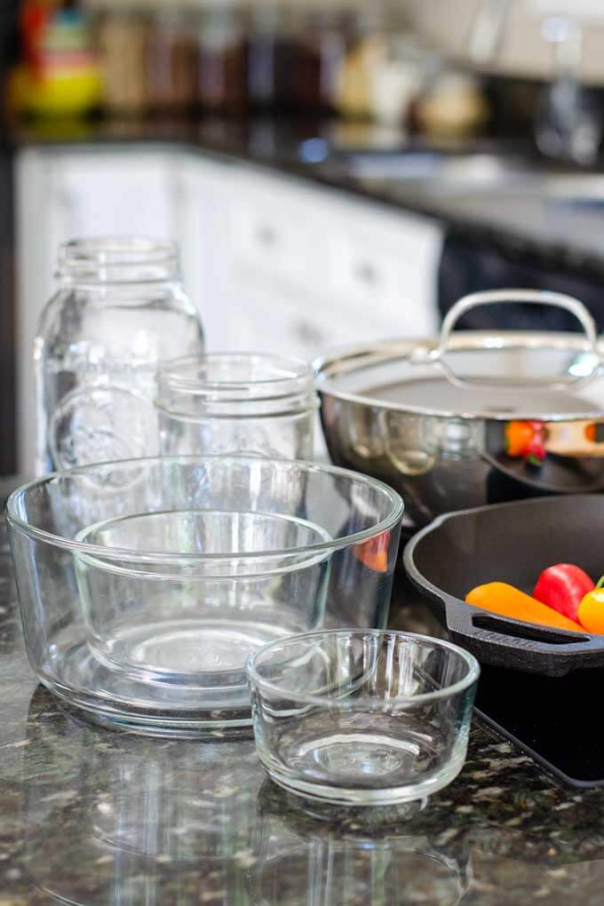 Healthy Non-Toxic Cookware and Kitchen Items - pyrex storage bowls, mason jars, cast iron skillet, stainless steel pan