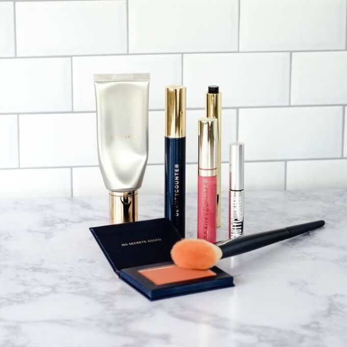 Flawless in five beautycounter five minute face with tinted moisturizer, mascara, concealer pen, lip gloss, brow gel and blush