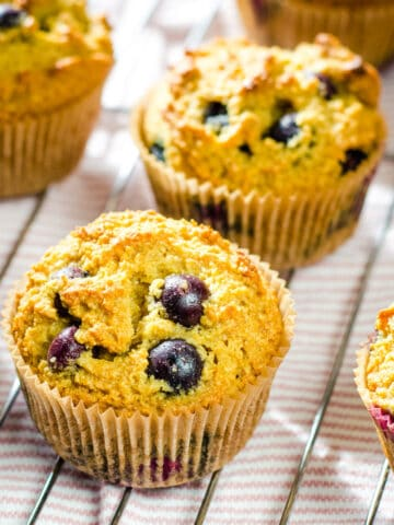 Almond flour blueberry muffins on cooling rack