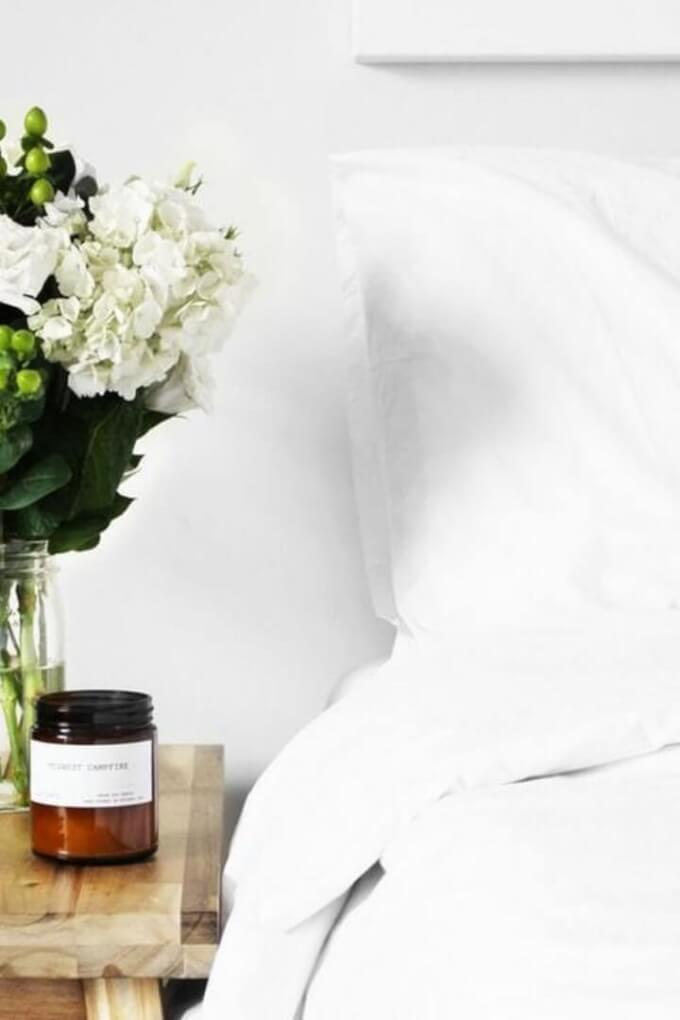 Bed and flowers for self care at home