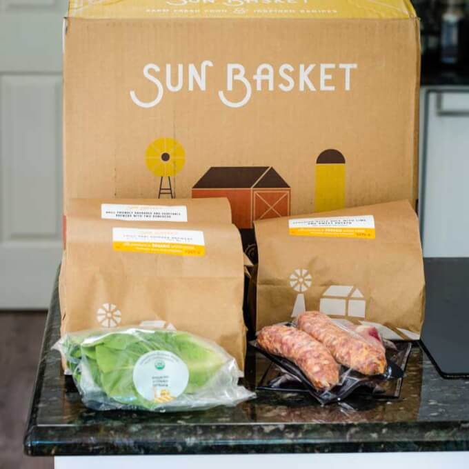 Sun Basket box and meal kits with ingredients lettuce and sausage