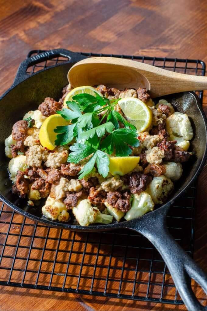 Lamb casserole with cauliflower in cast iron pan
