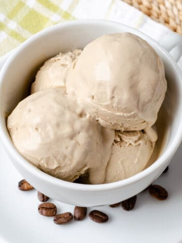 Coffee ice cream in coffee cup with coffee beans