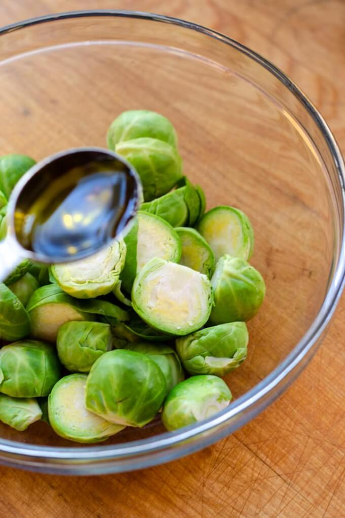 Brussels sprouts in bowl with olive oil
