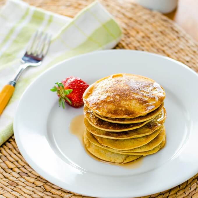 Banana pancakes with maple syrup and strawberry
