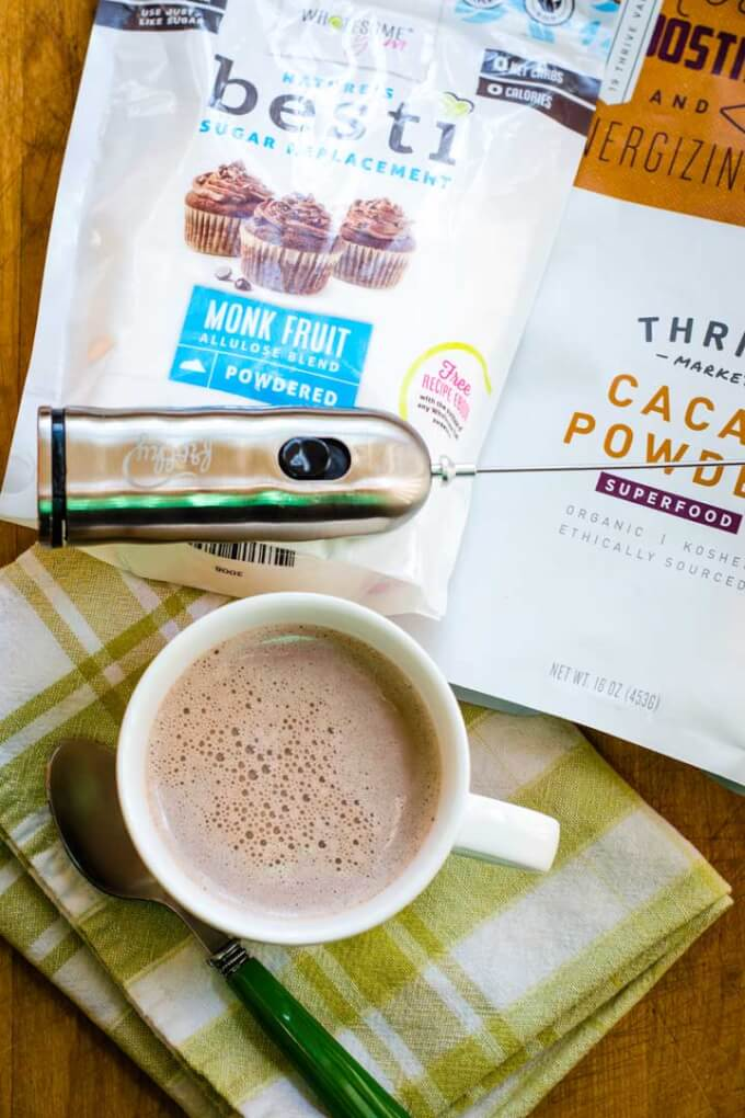 Mug of hot chocolate, monk fruit sweetener, cacao powder, milk frother