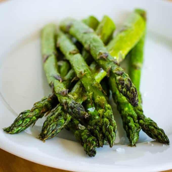 Roasted asparagus with sea salt on plate
