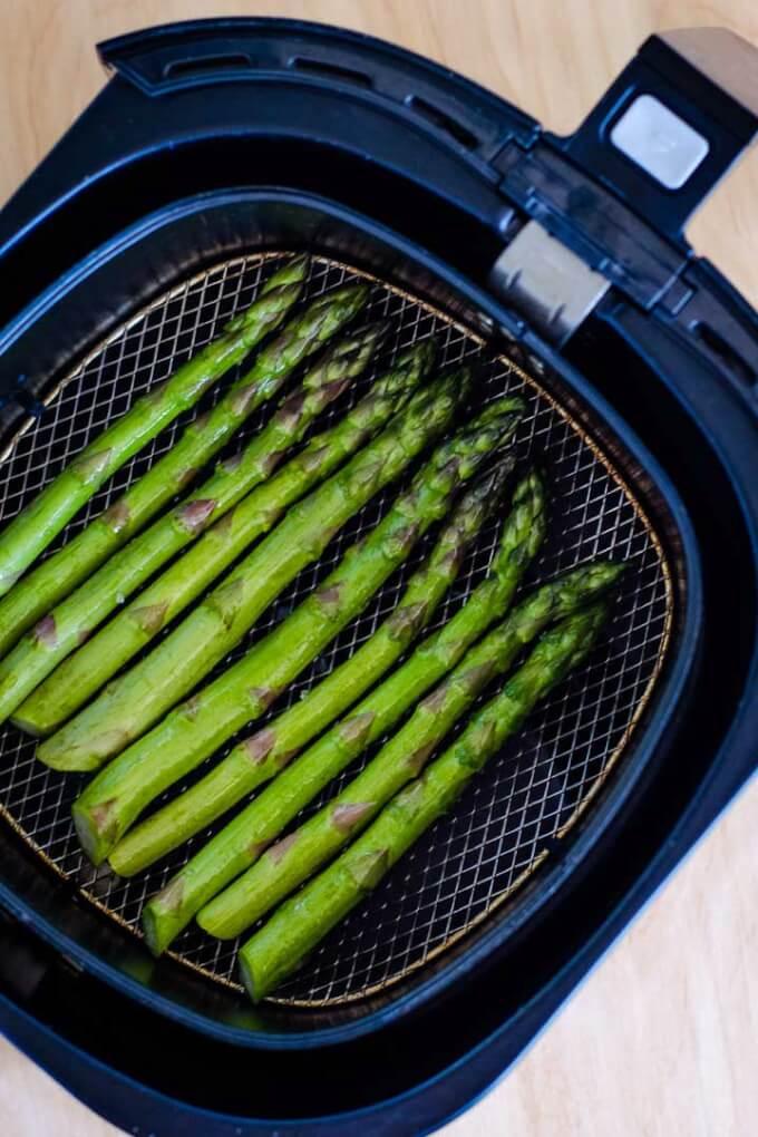 Roasted asparagus in air fryer basket
