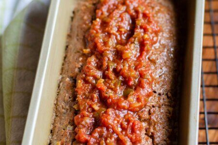 Spreading salsa on top of the meatloaf