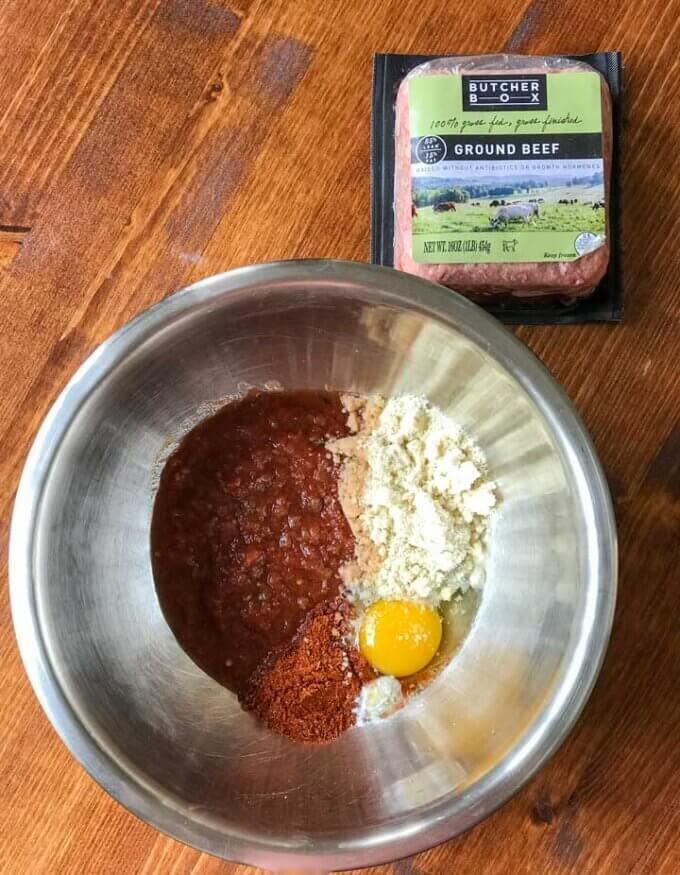 Ground beef, bowl with salsa, almond flour, egg, spices, baking soda